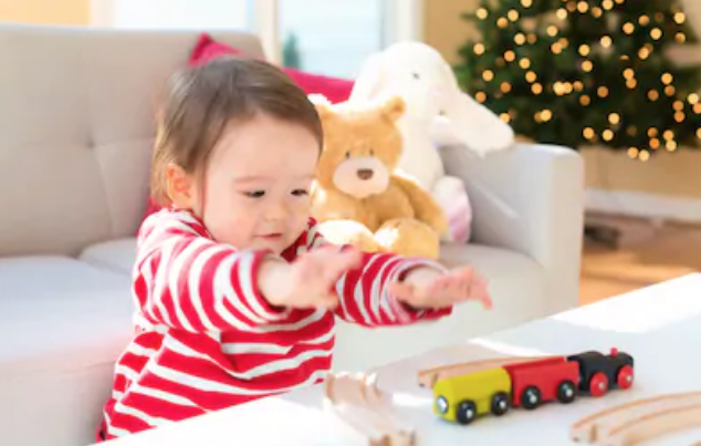 Toddler playing with toys at Christmas